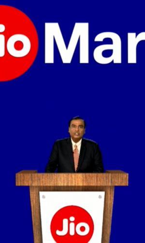 Mukesh Ambani wearing a black suit addresses shareholders at Reliance AGM on July 15
