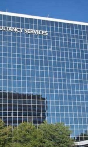 Glass panelled Tata Consultancy Services building with logo in white on top left