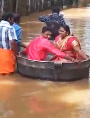 Roads flooded, this Kerala couple used a cooking vessel to reach their wedding