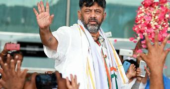 DK Shivakumar waves to supporters