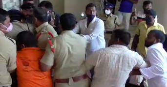 The ruckus outside the house and BJP karyakartas and police clash