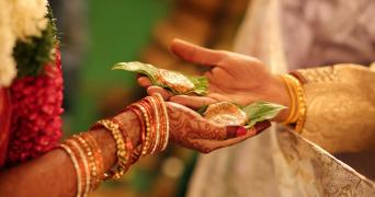 Representational image shows two hands during a Hindu wedding ritual