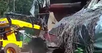 Bulldozer tearing down a shop