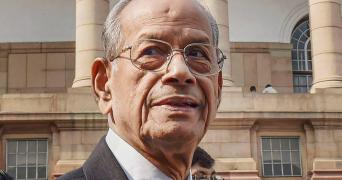 Close up shot of E Sreedharan in a suit and spectacles