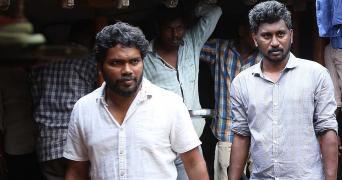 Pa Ranjith and writer Tamil Prabha on sets of Sarpatta Parambarai