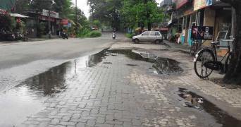 Muppathadam Road in Pathalam in Ernakulam. The street is deserted except for a two wheeler