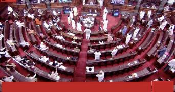 A view of the ruckus on the Farm Bill in Rajya Sabha as Opposition members stormed the well of the House in protest