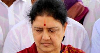 Sasikala in a red saree