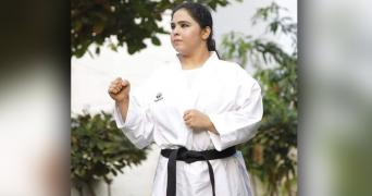 Syeda Falak in her Karate uniform and a black belt