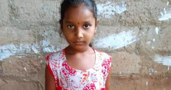 An image of Tulasi looking into the camera