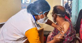 Nurse giving covid vaccination pti image