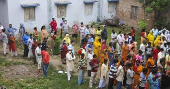People in West Bengal queue to cast their vote in the fourth phase of polling