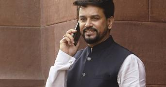 Anurag Thakur speaking on a mobile phone outside Parliament