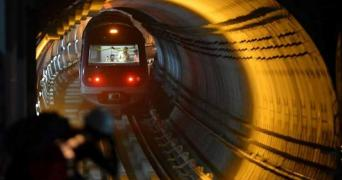 A Bengaluru metro train coming out of a tunnel