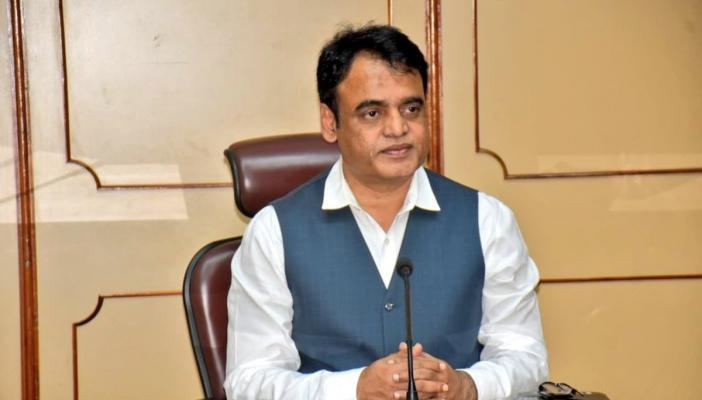 Karnataka Deputy Chief Minister Dr CN Ashwathnarayan seated in his office