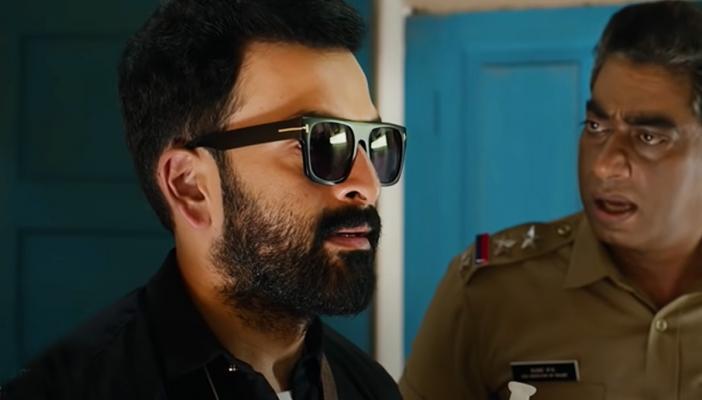 Prithviraj in Bhramam film wearing sunglasses and a black shirt