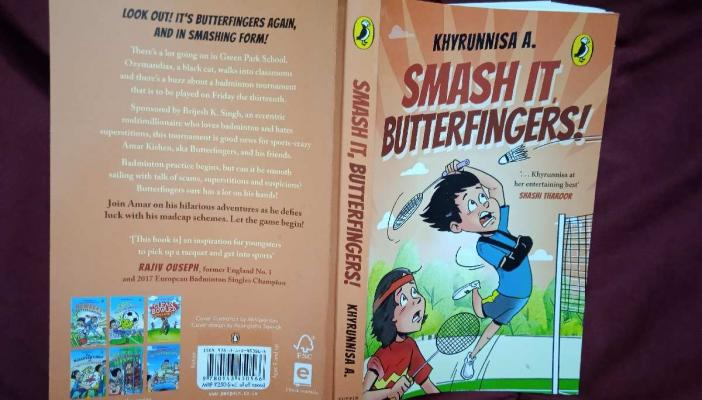 The peach cover of new Butterfingers novel - Smash it, Butterfingers! - with a picture of two boys playing badminton on the front and writings on the back