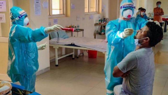 Health workers collecting samples for testing coronavirus
