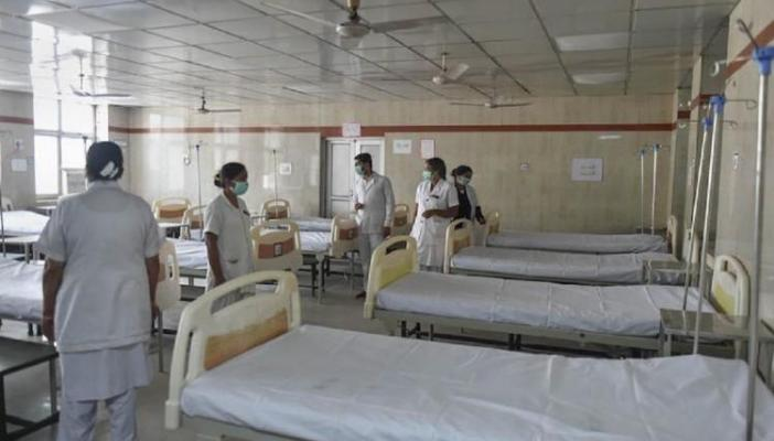 Healthcare professionals in a COVID-19 hospital ward