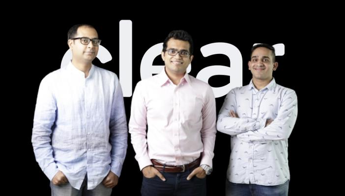 Clear's founders standing in front of the company logo