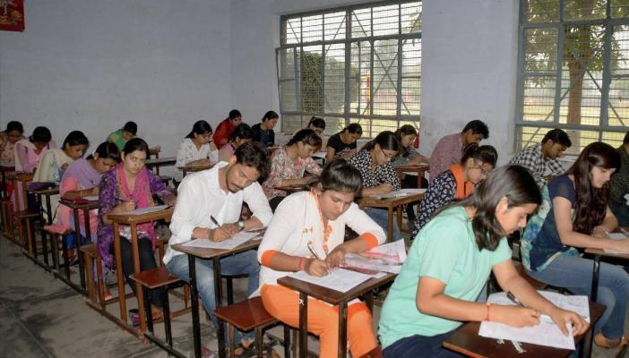 Aspirants writing a B Ed entrance examination in Uttar Pradesh