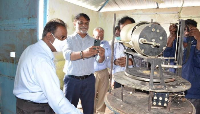 Officials looking at the musical flood warning system at Gandipet reservoir