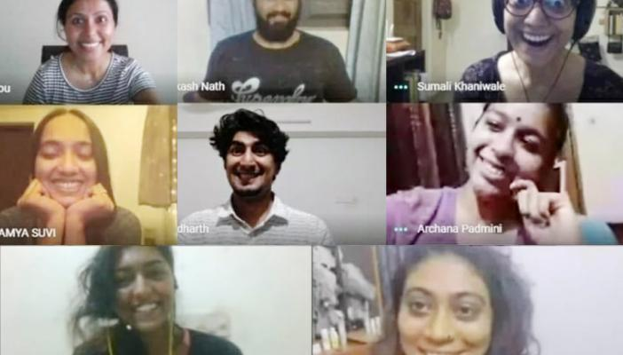 Eight people appear in different windows of a screen, all smiling and showing actions