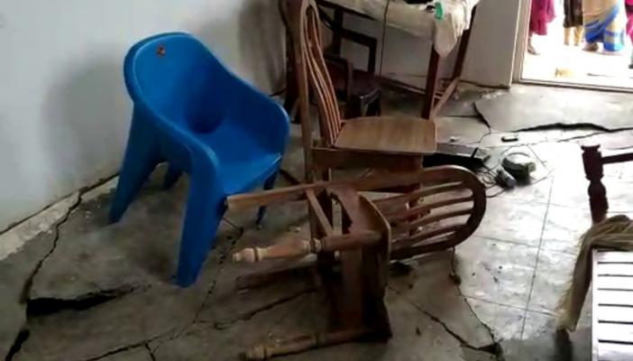 Cracks on floor due to rains in a 2BHK scheme house in Gajwel, Telangana