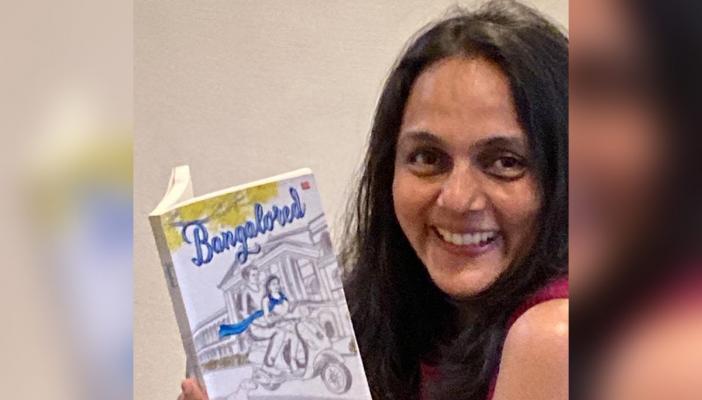 Gayatri Chandrasekhran posing with her book Bangalored