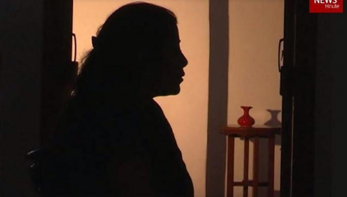Silhouette of a woman against a light source to represent the survivor.