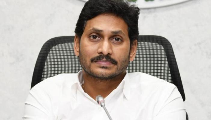 Y S Jagan in white shirt sitting in black chair