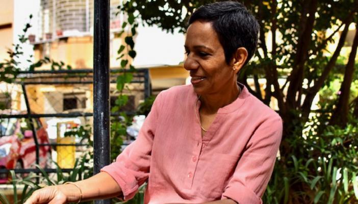 Author Kala Krishnan seated in a garden