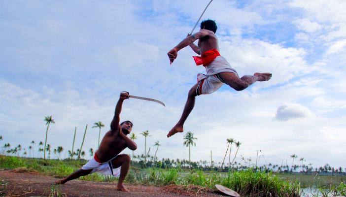 Warriors practicing kalaripayattu representational image