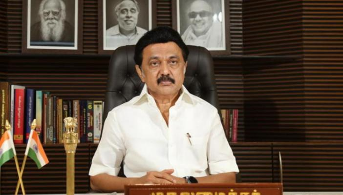 MK Stalin in his office with photos of Periyar, Karunanidhi in his office