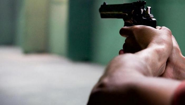 Man holding a black gun