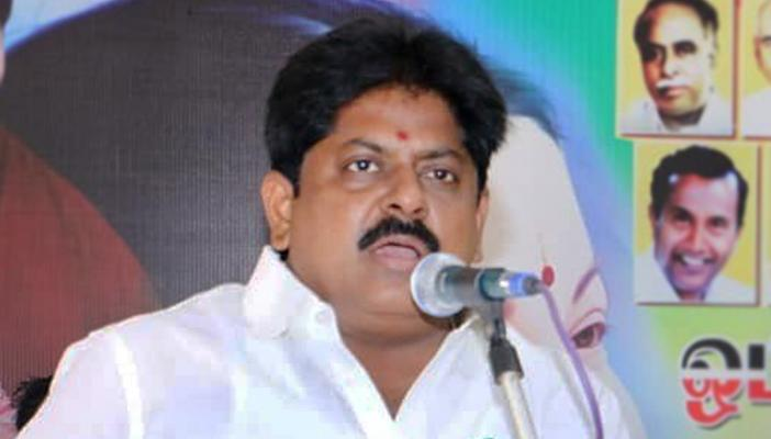 AIADMK former Minister M Manikandan speaks in front of mic
