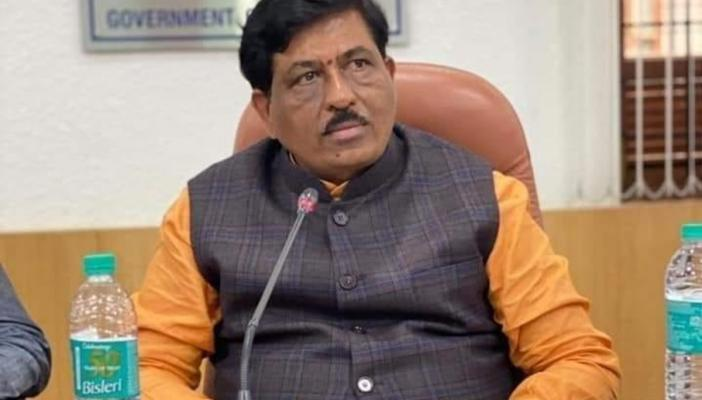 Murugesh Nirani seated during an official meeting