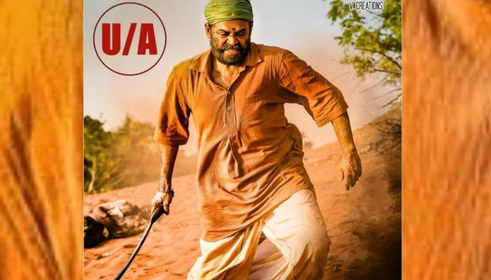 Narappa poster in which Venkatesh can be seen running with a knife in a rugged clothes