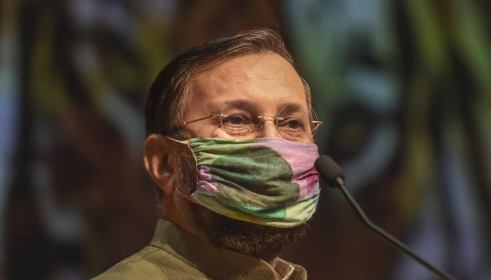 Union Minister of Environment, Forest and Climate Change Prakash Javadekar wears a mask during the release of a book and poster on the eve of International Tiger Day 2020