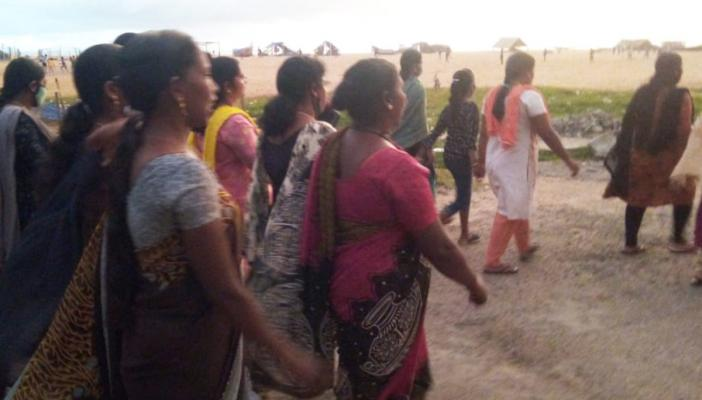 A group of women march in protest in a Kerala village