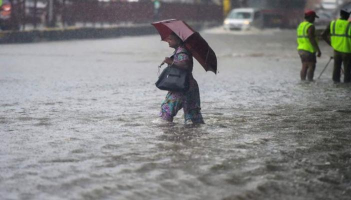 A woman during rains and flood