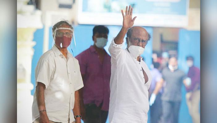 Actor Rajinikanth waves to the crowd as he goes for meeting of Rajini Makkal Mandram to Raghavendra Kalyana Madapam