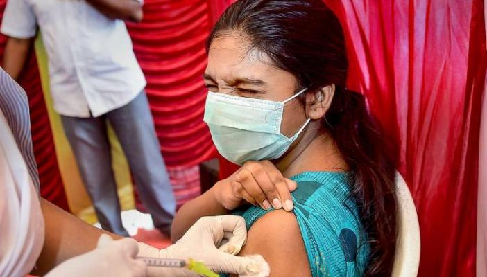 A girl in Tamil Nadu being vaccinated by a healthcare professional