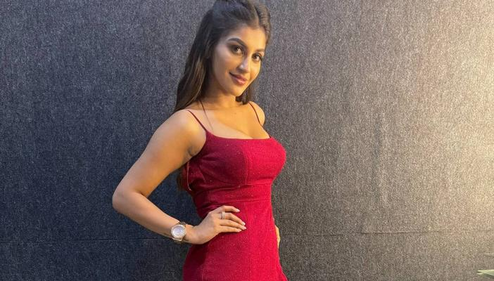 Actor Yashika Anand in a red dress