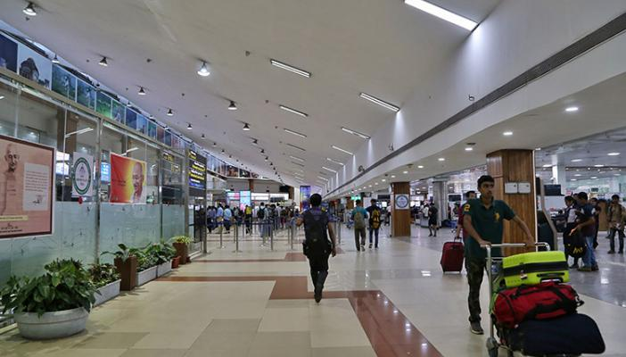 Passengers in a domestic airport in India