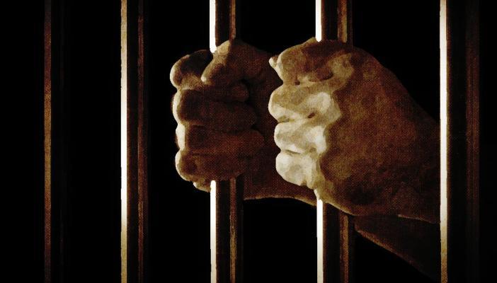 Hands inside prison
