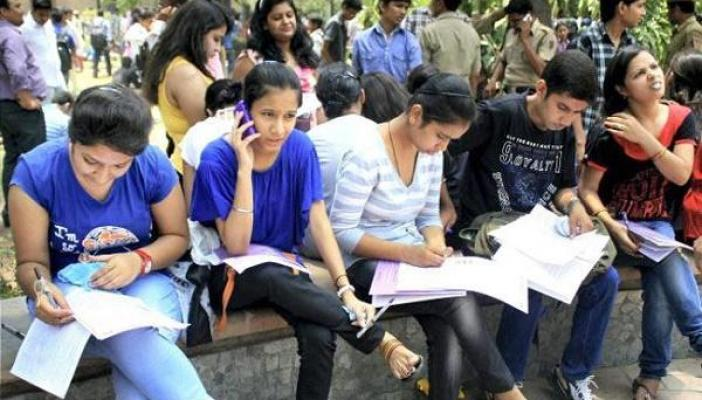 Photo of students outside their examination before pandemic