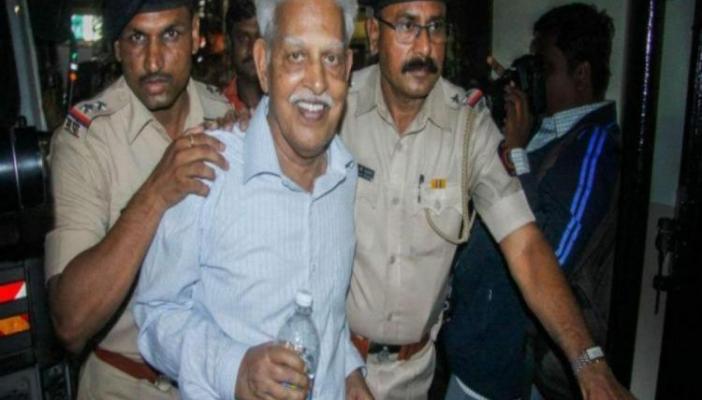 Poet varavara Rao being escorted by police
